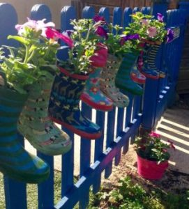 Wellies filled with flowers on WUFA railings